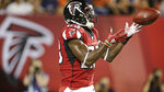 Atlanta Falcons running back Brian Hill catches a 1-yard touchdown pass during the first half of the team's Pro Football Hall of Fame NFL preseason game against the Denver Broncos, Thursday, Aug. 1, 2019, in Canton, Ohio. (AP Photo/Ron Schwane)