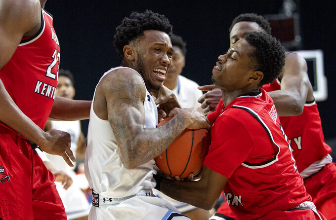Old Dominion guard Ahmad Caver tries to wrestle the ball away from Western Kentucky guard Lamonte Bearden, right, during the second half of an NCAA college basketball game for the Conference USA men's tournament championship, Saturday, March 16, 2019, in Frisco, Texas. Old Dominion won 62-56. (AP Photo/Jeffrey McWhorter)