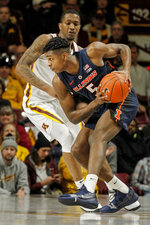 Illinois' Tevian Jones (5) tries to work around Minnesota's Dupree McBrayer during the first half of an NCAA college basketball game Wednesday, Jan. 30, 2019, in Minneapolis. (AP Photo/Bruce Kluckhohn)