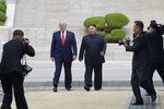 """FILE - In this June 30, 2019, file photo, U.S. President Donald Trump, center left, and North Korean leader Kim Jong Un walk on the North Korean side at the border village of Panmunjom in the Demilitarized Zone. North Korea on Saturday, June 13, 2020 again bashed South Korea, telling its rival to stop """"nonsensical"""" talk about its denuclearization and vowing to expand its military capabilities. (AP Photo/Susan Walsh, File)"""