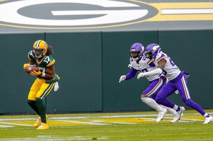 Green Bay Packers' Davante Adams catckes a touchdown pass during the first half of an NFL football game against the Minnesota Vikings Sunday, Nov. 1, 2020, in Green Bay, Wis. (AP Photo/Matt Ludtke)