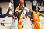 Tennessee guard Victor Bailey Jr. (12) pulls away a rebound from Mississippi forward Romello White (0) during the first half of an NCAA college basketball game in Oxford, Miss., Tuesday, Feb. 2, 2021. (AP Photo/Rogelio V. Solis)
