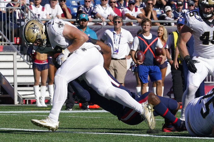 New Orleans Saints quarterback Taysom Hill (7) drives into the end zone for a touchdown during the second half of an NFL football game against the New England Patriots, Sunday, Sept. 26, 2021, in Foxborough, Mass. (AP Photo/Steven Senne)