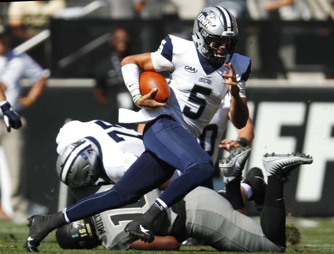 New Hampshire quarterback Christian Lupoli runs for a short gain against Colorado in the first half of an NCAA college football game Saturday, Sept. 15, 2018, in Boulder, Colo. (AP Photo/David Zalubowski)
