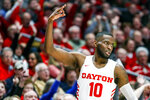 Dayton's Jalen Crutcher reacts after scoring a three-point shot during the first half of an NCAA college basketball game against St. Bonaventure, Wednesday, Jan. 22, 2020, in Dayton, Ohio. (AP Photo/John Minchillo)