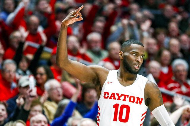 Dayton's Jalen Crutcher reacts after scoring a three-point shot during the first half of an NCAA college basketball game against St. Bonaventure, Wednesday, Jan. 22, 2020, in Dayton, Ohio. (AP Photo/John Minchillo)