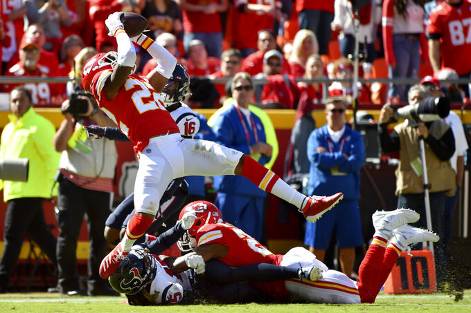 Kansas City Chiefs safety Juan Thornhill (22) intercepts a pass intended for Houston Texans wide receiver Keke Coutee (16) during the first half of an NFL football game in Kansas City, Mo., Sunday, Oct. 13, 2019. (AP Photo/Ed Zurga)