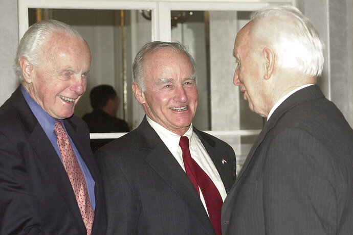 FILE - In this April 8, 2004, file photo, U.S. ambassador to Hungary, George Herbert Walker III, center, smiles as Hungarian President Ferenc Madl, right, shakes hands with U.S. congressman Tom Lantos, at the Presidential Palace in Budapest, Hungary. George Herbert Walker III, cousin of two presidents, a former U.S. ambassador to Hungary and a prominent St. Louis businessman and philanthropist, died Saturday, Jan. 18, 2020, according to the church handling his memorial service. He was 88. The cause of death was not disclosed. (AP Photo/Bela Szandelszky, File)