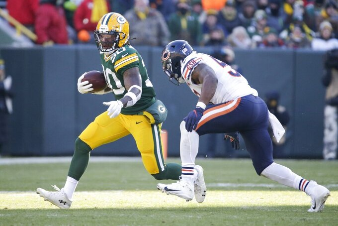 Green Bay Packers' Jamaal Williams runs during the first half of an NFL football game against the Chicago Bears Sunday, Dec. 15, 2019, in Green Bay, Wis. (AP Photo/Mike Roemer)