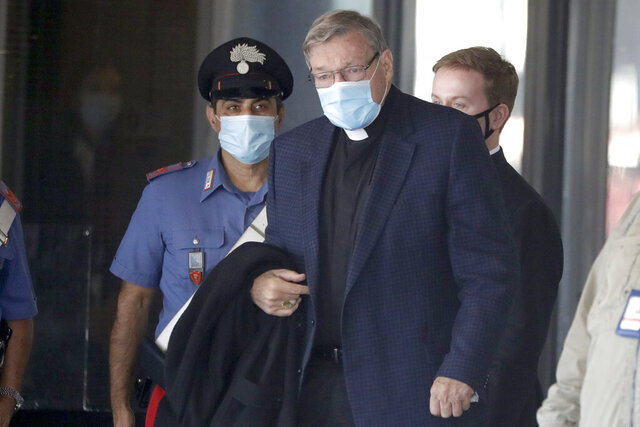 Australian Cardinal George Pell arrives at Rome's international airport in Fiumicino, Wednesday, Sept. 30, 2020. Pell took a leave of absence from his job in 2017 to stand trial in his native Australia on historic child sexual abuse charges, for which he was ultimately acquitted. (AP Photo/Andrew Medichini)