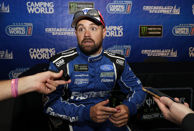 Ricky Stenhouse Jr., talks to media during a practice for the NASCAR Sprint Cup Series auto race at Chicagoland Speedway in Joliet, Ill., Saturday, June 29, 2018. (AP Photo/Nam Y. Huh)