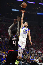 Golden State Warriors guard Stephen Curry, right, shoots as Los Angeles Clippers forward JaMychal Green defends during the first half in Game 3 of a first-round NBA basketball playoff series Thursday, April 18, 2019, in Los Angeles. (AP Photo/Mark J. Terrill)
