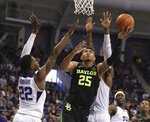 Baylor forward Tristan Clark, right, attempts a basket over TCU guard RJ Nembhard, left, in the second half of an NCAA college basketball game, Saturday, Jan. 5, 2019, in Fort Worth, Texas. (Rod Aydelotte/Waco Tribune Herald, via AP)/Waco Tribune-Herald via AP)