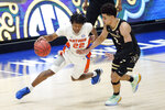 Florida's Tyree Appleby (22) drives against Vanderbilt's Scotty Pippen Jr. (2) in the first half of an NCAA college basketball game in the Southeastern Conference Tournament Thursday, March 11, 2021, in Nashville, Tenn. (AP Photo/Mark Humphrey)