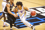 LSU forward Trendon Watford (2) makes a move around the defense of St. Bonaventure guard Dominick Welch (1) during the second half of a first round game in the NCAA men's college basketball tournament, Saturday, March 20, 2021, at Assembly Hall in Bloomington, Ind. (AP Photo/Doug McSchooler)