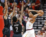 Cleveland Cavaliers guard Cameron Payne, right, passes the ball as Houston Rockets guards Brandon Knight (2) and Gerald Green defend during the first half of an NBA basketball game Friday, Jan. 11, 2019, in Houston. (AP Photo/Eric Christian Smith)