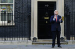Britain's Prime Minister Boris Johnson applauds on the doorstep of 10 Downing Street, during the weekly