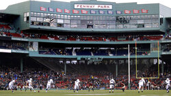 Yale's Devin Moore (87) winds up for the opening kick-off against Harvard during an NCAA college football game at Fenway Park in Boston, Saturday, Nov. 17, 2018. (AP Photo/Charles Krupa)