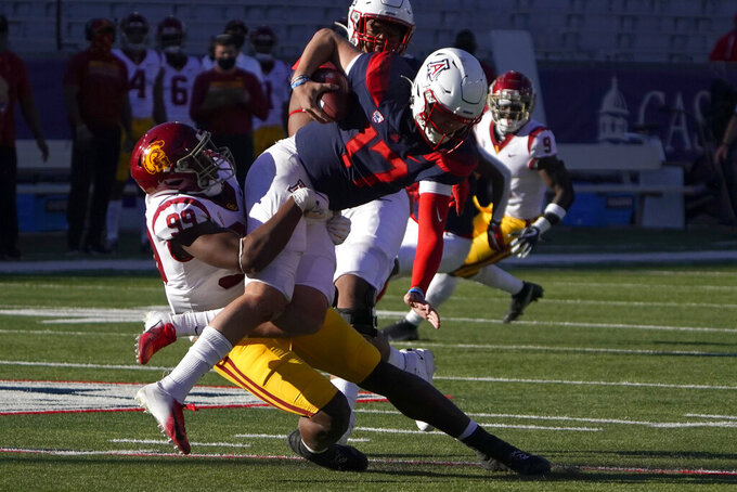 Southern California linebacker Drake Jackson (99) sacks Arizona quarterback Grant Gunnell (17) in the second half during an NCAA college football game, Saturday, Nov. 14, 2020, in Tucson, Ariz. (AP Photo/Rick Scuteri)