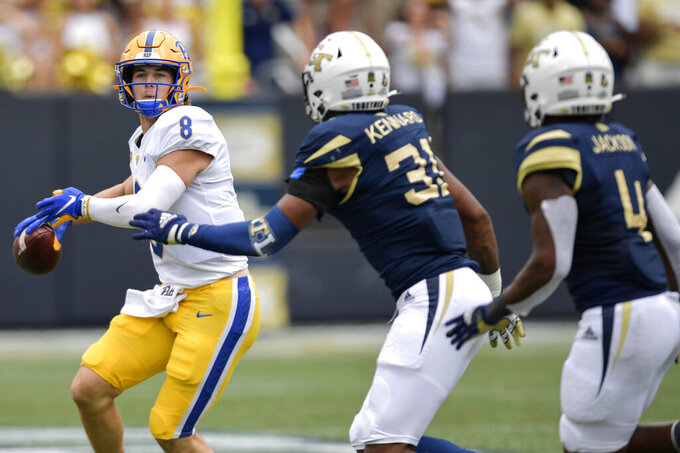 Pittsburgh quarterback Kenny Pickett (8) works against Georgia Tech during the first half of an NCAA college football game, Saturday, Oct. 2, 2021, in Atlanta. (AP Photo/Mike Stewart)