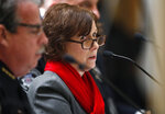 Jane Dougherty, a resident of Littleton, Colo., who lost her sister, Mary Sherlack, in the mass shooting in Newtown, Conn., speaks during a hearing before the House Judiciary Committee on a bill to get a