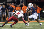 Illinois' Reggie Corbin (2) fends off Nebraska defender Caleb Tannor (2) in the first half of an NCAA college football game, Saturday, Sept. 21, 2019, in Champaign, Ill. (AP Photo/Holly Hart)