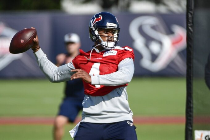 Houston Texans quarterback Deshaun Watson (4) throws the ball during NFL football practice Wednesday, July 28, 2021, in Houston. (AP Photo/Justin Rex)