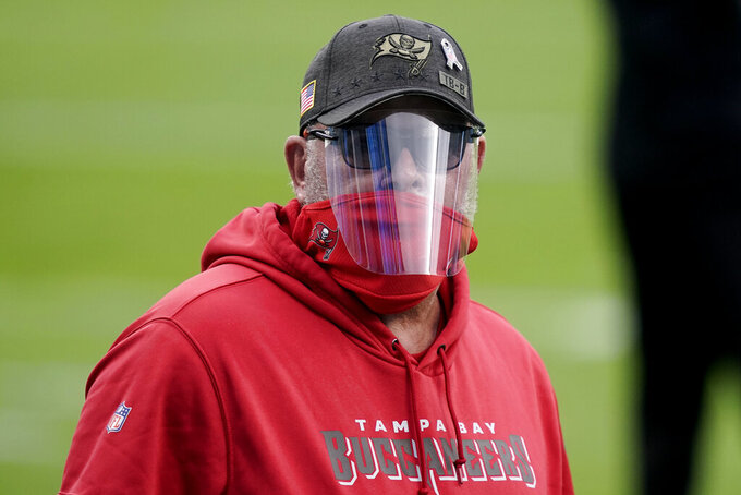 Tampa Bay Buccaneers head coach Bruce Arians walks the turf before the first half of an NFL football game between the Carolina Panthers and the Tampa Bay Buccaneers, Sunday, Nov. 15, 2020, in Charlotte , N.C. (AP Photo/Gerry Broome)
