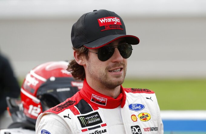 Ryan Blaney stands next to his car before the NASCAR cup series auto race at Michigan International Speedway, Monday, June 10, 2019, in Brooklyn, Mich. (AP Photo/Carlos Osorio)