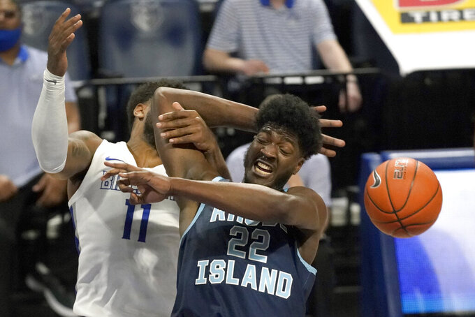 Rhode Island's Makhel Mitchell (22) reaches for a rebound as Saint Louis' Hasahn French (11) defends during the second half of an NCAA college basketball game Wednesday, Feb. 10, 2021, in St. Louis. (AP Photo/Jeff Roberson)
