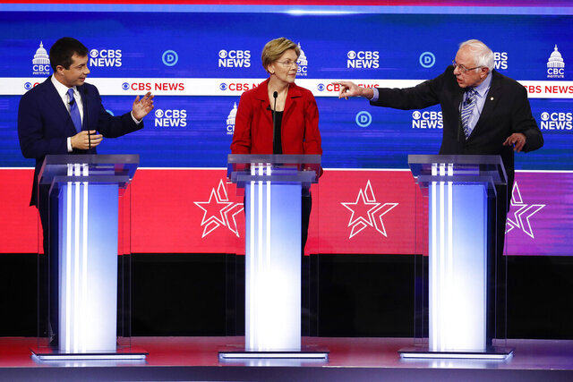 From left, Democratic presidential candidates, former South Bend Mayor Pete Buttigieg, Sen. Elizabeth Warren, D-Mass., and Sen. Bernie Sanders, I-Vt., participate in a Democratic presidential primary debate at the Gaillard Center, Tuesday, Feb. 25, 2020, in Charleston, S.C., co-hosted by CBS News and the Congressional Black Caucus Institute. (AP Photo/Patrick Semansky)