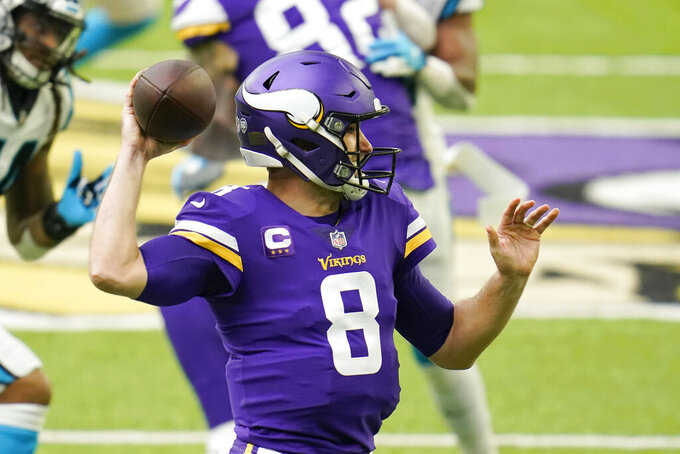 Minnesota Vikings quarterback Kirk Cousins throws a pass during the first half of an NFL football game against the Carolina Panthers, Sunday, Nov. 29, 2020, in Minneapolis. (AP Photo/Jim Mone)