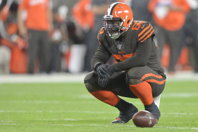 FILE - In this Sept. 22, 2019, file photo, Cleveland Browns defensive tackle Larry Ogunjobi (65) reacts during an NFL football game against the Los Angeles Rams in Cleveland. The Browns will be without one of their best defensive players Sunday against Indianapolis as Ogunjobi will sit out with an abdominal injury. (AP Photo/David Richard, File)