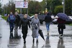 Alyona Popova, the democratic Yabloko party candidate for the State Duma, center, walks in a street before a meeting with voters in Moscow, Russia, Friday, Sept. 3, 2021. Popova is running in a Moscow district, and her competitors include a famous TV personality widely seen as pro-government and a seasoned lawmaker from the Communist Party. (AP Photo/Pavel Golovkin)