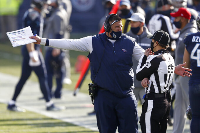 Tennessee Titans head coach Mike Vrabel talks with line nudge Walt Coleman IV (65) in the first half of an NFL wild-card playoff football game against the Baltimore Ravens Sunday, Jan. 10, 2021, in Nashville, Tenn. (AP Photo/Wade Payne)