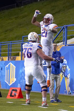 Boise State running back Andrew Van Buren (21) celebrates with teammate Ezra Cleveland (76) after rushing for a touchdown against San Jose State during the second half of an NCAA college football game, in San Jose, Calif., Saturday, Nov. 2, 2019. (AP Photo/Tony Avelar)