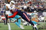 New England Patriots outside linebacker Matt Judon (9) tackles Miami Dolphins quarterback Tua Tagovailoa (1) during the second half of an NFL football game, Sunday, Sept. 12, 2021, in Foxborough, Mass. (AP Photo/Winslow Townson)
