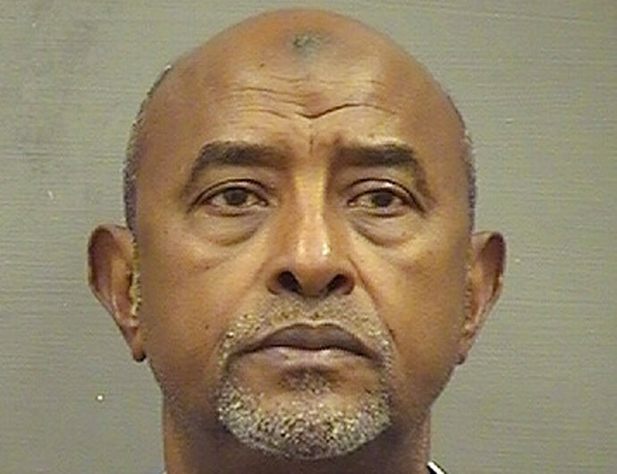FILE - This Saturday, May 4, 2019, file booking photo provided by the Alexandria, Va. Sheriff's Office shows Abdirizak Jaji Raghe Wehelie, of Burke, Va. Wehelie, a former FBI translator charged with altering transcripts after his own voice was caught on intercepts with terrorism suspects, is expected to enter a guilty plea, Friday, Nov. 8, 2019, in federal court in Alexandria. (Alexandria Sheriff's Office via AP)