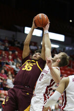Arizona State forward Taeshon Cherry (35) and Washington State forward Jeff Pollard (13) go after a rebound during the second half of an NCAA college basketball game in Pullman, Wash., Wednesday, Jan. 29, 2020. Washington State won 67-65. (AP Photo/Young Kwak)