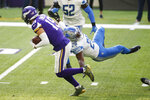 Minnesota Vikings wide receiver Adam Thielen, left, runs from Detroit Lions safety Duron Harmon (26) after catching a pass during the first half of an NFL football game, Sunday, Nov. 8, 2020, in Minneapolis. (AP Photo/Bruce Kluckhohn)