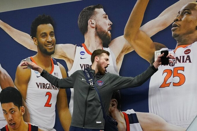 Virginia's Jay Huff poses by him picture on the hall after a practice session for the semifinals of the Final Four NCAA college basketball tournament, Thursday, April 4, 2019, in Minneapolis. (AP Photo/David J. Phillip)