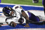 Baltimore Ravens quarterback Lamar Jackson (8) reacts after being injured during the second half of an NFL divisional round football game against the Buffalo Bills Saturday, Jan. 16, 2021, in Orchard Park, N.Y. (AP Photo/Adrian Kraus)
