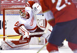 Florida Panthers center Alex Wennberg (21) shoots past Detroit Red Wings goaltender Thomas Greiss (29) in overtime of an NHL hockey game Thursday, April 1, 2021, in Sunrise, Fla. (AP Photo/Jim Rassol)
