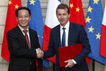 President of Airbus's commercial aircraft business, Guillaume Faury, right, and Chairman of China Aviation Supplies Co. (CASC) Jia Baojun, left, shake hands during an agreement signing ceremony at the Elysee Palace in Paris, France, Monday, March 25, 2019. Chinese President Xi Jinping was greeted with full honors Monday during a state visit to France in which he is expected to sign multibillion-dollar deals on energy, the food industry, transport and other sectors as well as a bilateral statement on climate change. (Yoan Valat/Pool Photo via AP)