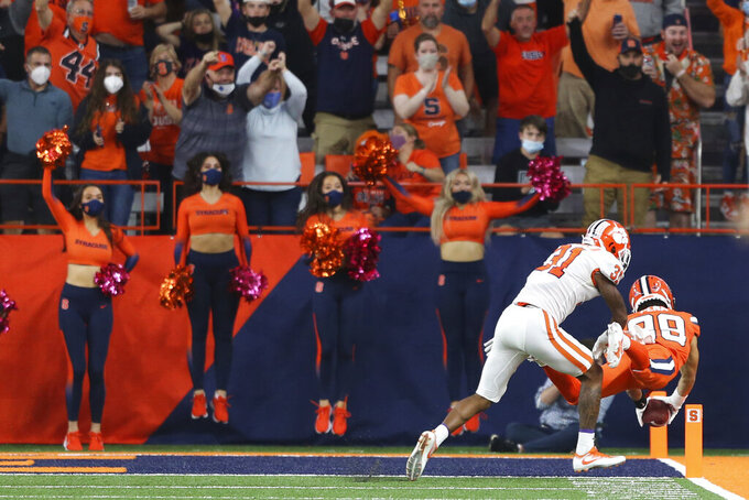 Syracuse wide receiver Trebor Pena (29) dives into the end zone after a catch during the fourth quarter of a NCAA football game against Clemson in Syracuse, N.Y., Friday, Oct. 15, 2021. (AP Photo/Joshua Bessex)
