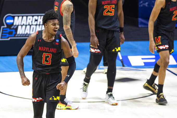Maryland's Hakim Hart (13) celebrates late in the second half of the team's first-round game against Connecticut in the NCAA men's college basketball tournament Saturday, March 20, 2021, at Mackey Arena in West Lafayette, Ind. Maryland won 63-54. (AP Photo/Robert Franklin)