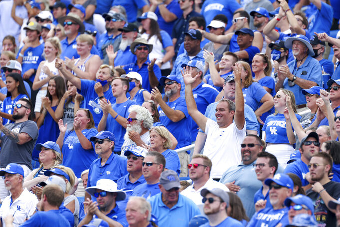 Kentucky fans celebrate a touchdown during the second half of a NCAA college football game against Chattanooga in Lexington, Ky., Saturday, Sept. 18, 2021. (AP Photo/Michael Clubb)
