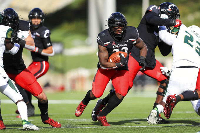 Cincinnati running back Gerrid Doaks carries the ball during the first half of an NCAA college football game against South Florida, Saturday, Oct. 3, 2020, in Cincinnati. (AP Photo/Aaron Doster)