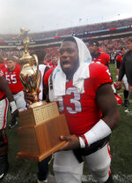 Georgia center Lamont Gaillard (53) reacts as he carries the Governor's Cup off the field after defeating Georgia Tech 45-21 in an NCAA college football game Saturday, Nov. 24, 2018, in Athens, Ga. (AP Photo/John Bazemore)