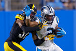Carolina Panthers wide receiver D.J. Moore is tackled by Pittsburgh Steelers cornerback Justin Layne during the first half of a preseason NFL football game Friday, Aug. 27, 2021, in Charlotte, N.C. (AP Photo/Nell Redmond)